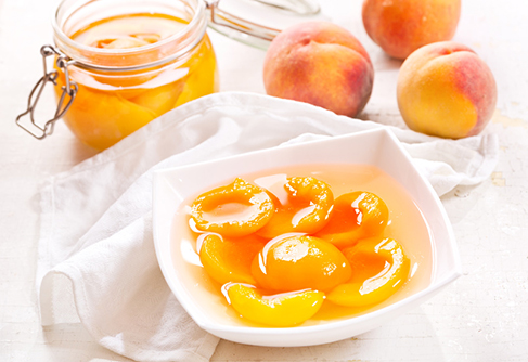 canned peaches in a bowl